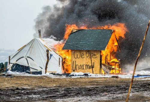 hut-in-fire-oceti-camp-720x490